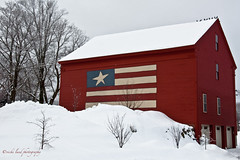 Flag on A Red Barn (Vicki Lund Photography) Tags: new travel trees winter red england sky snow streets history tourism window colors architecture buildings shopping geotagged landscapes raw photographer village seascapes view side fineart rustic barns maine newengland naturallight front flags february giftshop freelance snowcoveredtrees countryroads countrystore redbarns homesteads stumbleupon timberframe mechanicfalls 2011 winter shingled farmsteads maineusa nikond90 rusticbarns mainenewengland mainephotographer whitebarns greenbarns yellowbarns newenglandbarns mainetrees vickilundphotography mainebarns copywrite wwwvickilundphotographycom httponfbmevickilundphotographywelcome mainegov vickilund shingledbarns vickilundmaine vickilundbarns barnsusa northamericabarns httpaboutmevickilundphotography