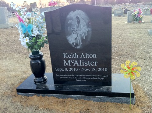 New flowers and a pinwheel for Keith's grave