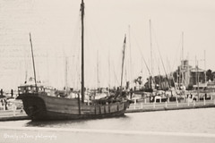the dock (life stories photography) Tags: bw blur coast boat 2010 corpuschristitexas missingthewarmweather