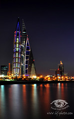 Bahrain Trade Center - Manama ( Hussain Frutan | www.hf-photos.net) Tags: bridge blue b sea sky panorama black reflection water fountain set night speed lens landscape photography boat bahrain amazing nikon rocks long exposure purple shot photos harbour d blues center reflect smokey 5000 18 scape 35 trade financial vr manama arad bahrian hussain   fozool cloued   muharaq d5000 moharaq   maharaq ma7araq frutan wwwhfphotoscom