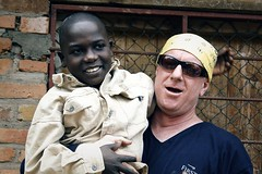 Bobby holds a small local child.