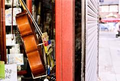 Hello Cello (opu) Tags: shop liverpool 50mm shutters f18 portra vc zuiko om2 160 greenbankroad
