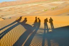 Desert Trekkers (Mo Baig) Tags: travel silhouette sand nikon desert dunes uae resort abudhabi unitedarabemirates 2011 colorphotoaward nikond90 nikonflickraward flickraward nikkor35mmf18afs mygearandme qasralsarab mygearandmepremium mygearandmebronze mygearandmesilver mygearandmegold mygearandmeplatinum aboveandbeyondlevel1 aboveandbeyondlevel2