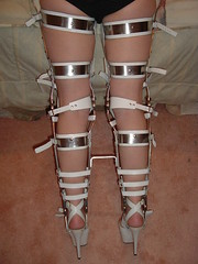 Rear View of the Leg Braces with Kneepads and 5th Strap (KAFOmaker) Tags: feet leather fetish foot high control legs braces lock sandals steel leg wrapped encased bondage device strap torso heel elk straight tight bound buckle locked brace restricted sandal joint buckles chained immobilized restraint restriction polio laced kafo restrained encase orthopedic imprisoned strapped heeled braced restrict buckled encircled immobilize tightly kneepad tlso tlso1