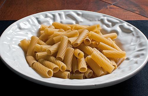 uncooked Rigatoni pasta in bowl