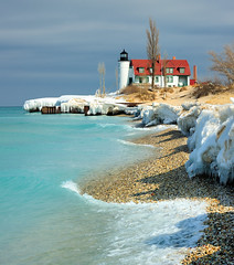"""March Thaw""  Point Betsie Lighthouse - Crystallia, Michigan (Michigan Nut) Tags: usa lighthouse ice sunrise geotagged photography spring melting waves stones michigan lakemichigan icicles aquablue michiganlighthouses pointbetsielighthouse thawingice michigannutphotography nikonnikkor70300mmf4556gedifafsvrtelephotozoomlens"