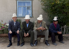 Old Men With Kalpak Hats at Funerals , Kochkor, Kyrgyzstan (Eric Lafforgue) Tags: old people male men hat horizontal bench four person togetherness asia sitting exterior fulllength together elder wisdom centralasia kyrgyzstan wrinkles humanbeing funerals colorphoto headgear fourpeople kochkor 9412 kyrgyzrepublic kirghizistan kirgistan kalpak lookingatcamera kirghizstan kirgisistan fourpersons traditionalhat calpack  calpac   traditionalheadgear quirguizisto kalpakhat kalpac qalpaq