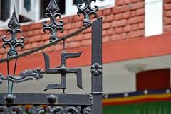 Swastika on gate, Dharamsala, India (CultureWise) Tags: swastika india symbols