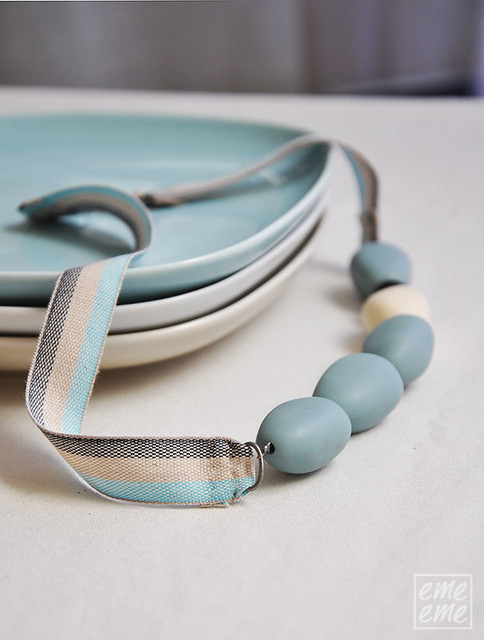 Necklace with light blue resin beads and linen ribbon
