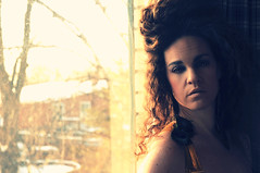 Week 3 of 52 [ warmth of the sun ] (DaizyB) Tags: winter light woman sun selfportrait cold window self hair outside daylight nikon skin expression feathers warmth curls curly freckles earrings shoulder gaze reflector distant d300 blueribbonwinner 52weeks