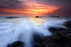 The wind is chill, but let it whistle as it will. (tropicaLiving - Jessy Eykendorp) Tags: light sunset bali seascape beach nature canon reflections indonesia landscape lava rocks wave reverse splash filters volcanic 1022mm tanahlot gnd melasti singhray canoneos50d