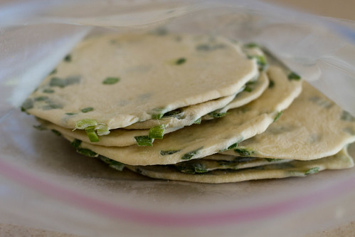 raw scallion pancakes after a night in the freezer