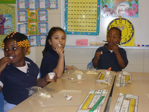 "First graders at E. J. Brown Elementary School in Dayton, Ohio, eat cauliflower with lowfat ranch dip, as part of their school's Fresh Fruit and Vegetable Program. According to school nurse Virginia Noe, the students ""gobbled up"" the cauliflower, with and without the dip."