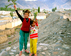 pamiri sisters (Xuan Che) Tags: 2005 china street city travel girls sunset summer portrait mountain west children highway peace village border august blonde xinjiang silkroad karakoram tajik centralasia canonixus400 islamic pamir eurasia tashkurgan indoeuropean pamiri highplateau