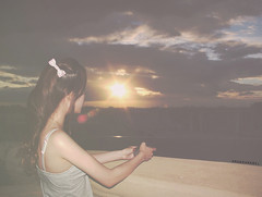 Day 79/365 ~ Wherever You Go, no matter What the Weather, always Bring your Own Sunshine (Amanda Mabel) Tags: light sunset sky orange brown sun girl sunshine clouds photoshop hair lens evening day ray bright dusk quote balcony flash bow flare ribbon 365 leaning 79 anthonyjdangelo whereveryougonomatterwhattheweatheralwaysbringyourownsunshine amandamabel