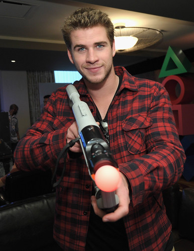 Actor Liam Hemsworth checks out the latest PS3 games while kicking back at the PlayStation NBA All-Star Players Lounge on February 18, 2011 in Los Angeles, California.