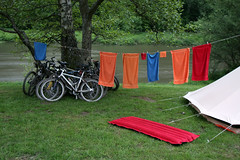 Laundry drying on line (!.Keesssss.!) Tags: camping tree grass bicycle horizontal outdoors photography day belgium towel nopeople tent transportation hanging clothesline protection gettyimages clothespin drying absence royaltyfree colorimage poolraft theflickrcollection keessmans 150ksgetty