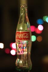 Coca Bokeh (JasonMK™) Tags: night canon mexico lights bottle glow bokeh maryland coke soda cocacola canonef50mmf14usm flickraward canoneos500d flickrbronzeaward flickrsilveraward platinumheartaward thebestofday gününeniyisi t1i cocabokeh doublyniceshot tripleniceshot flickraward5 mygearandme mygearandmepremium flickraward10 flickrawardgallery ringexcellence dblringexcellence karampatsos aboveandbeyondlevel1 jasonmk