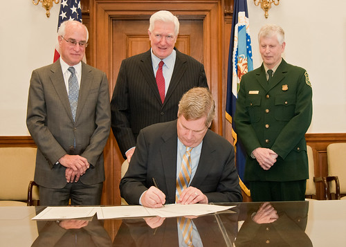 "Agriculture Secretary Tom Vilsack signs the centennial of the ""Week's Act Proclamation."" Behind Secretary Vilsack from the left are: Harris Sherman, Undersecretary, National Resources and Environment, Congressman Jim Moran, Virginia and Tom Tidwell, Chief, National Forest Service. The event took place at the U.S. Department of Agriculture in Washington, D.C., on Wednesday, March 2, 2011. The ""Week's Act Proclamation"" named for Representative John Weeks of Massachusetts became law March 1, 1911 and ranks among the significant natural resource conservation achievements of the 20th Century which led to the creation of the National Forests throughout the east and additions of national forests and grasslands across the United States and Puerto Rico. USDA Photo by Bob Nichols."