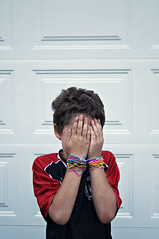 Silly band boy (georgekamelakis) Tags: door boy red portrait silly color colors face contrast photoshop hair photography photo band hide trend edit bandz