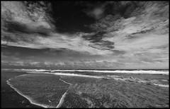 Pea Island Wavy Beach (CallihanImages) Tags: efs1018mmf4556isstm efs1018mm efs 10mm canoneos70d canon70d canon 70d blackandwhite black white bw beach peaisland peaislandnationalwildliferefuge obx sky clouds waves ocean