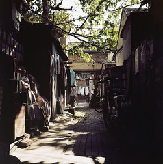 The Law of alley ( ken ) Tags: life china street shadow 120 6x6 film alley kodak beijing laundry greatwall        ektacolorpro160