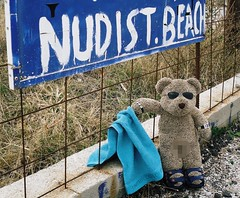 Ted at Faliraki nudist beach October 2009 - censored version (pefkosmad) Tags: bear vacation holiday ted cute beach sign strand pose naked nude greek islands funny teddy sandals bare hellas posing towel censored greece kawaii plushie nudist greekislands griechenland rhodes 2009 fkk peluche faliraki dodecanese pixilated fullfrontal nudistbeach rodhos unlimitedphotos tedatfalirakinudistbeachoctober2009 tedricstudmuffin tedricstudmufin