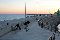 Skateboarding at sunset (Cardonz) Tags: sunset lighthouse canon faro tramonto mare skateboarding liguria porto cielo skate lampioni imperia 550d oneglia