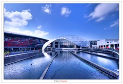 Ferrari world (Damon | Photography) Tags: world trip morning travel cloud reflection building water fountain clouds race speed island nikon dubai united uae fast sigma ferrari racing arab mm build polarizer abu dhabi damon hdr circular yas circularpolarizer hoya clp sigma1020mm 77mm 2011 d90 photomatix emarites emirites nikond90 clp77mm