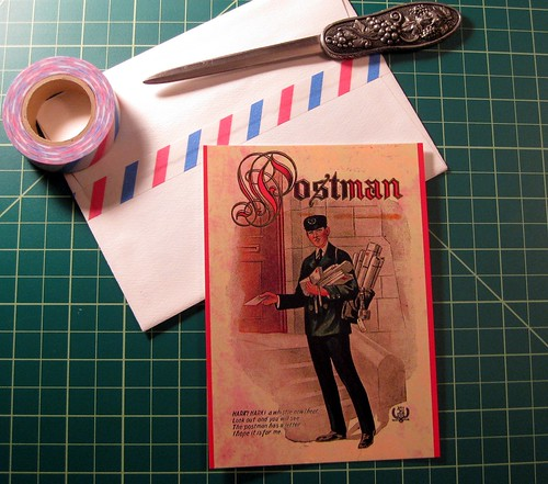 Postman postcard on desk