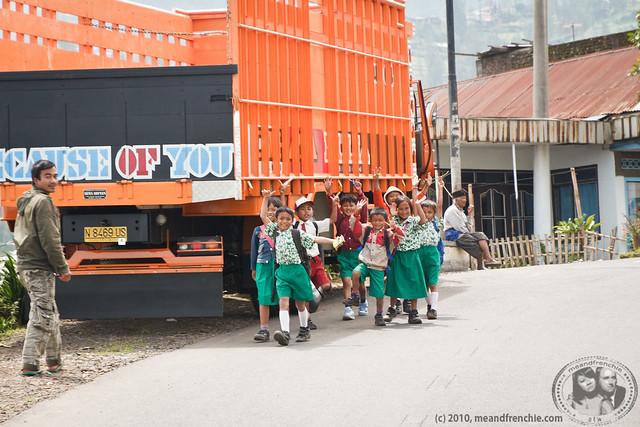Kids In School Uniforms Waving To Us