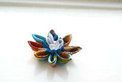 Kanzashi -Turquoise Waterlily (cuttlefishlove) Tags: flower japan japanese petals brooch silk craft ornament folding hairclip kanzashi fascinator hairornament habotai habotae