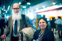 Peter and Azra Meadows (TGKW) Tags: old portrait people woman white man smile beard glasses airport long university dubai bokeh expression glasgow dr meadows s peter elderly pakistani professor spectacles azra academics biologists obe 8692 naturalists
