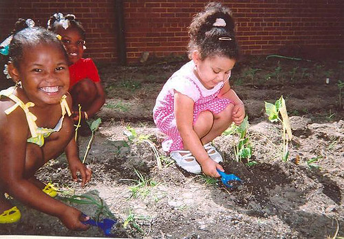 (Left to right) Keniyah Brown, Gerkyhia Walker and Alexis Cook have fun tending their garden at Woodlawn Learning Center in Hopewell, Va.