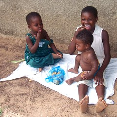 Enjoying themselves (Nasaldog) Tags: africa boy food girl child ghana jirapa babile upperwestregion chauw childhealthactionupperwest gbolo