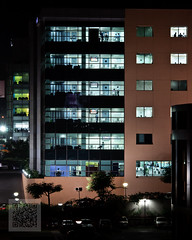 Corporate Life (break time) (pangalactic gargleblaster and the heart of gold) Tags: building night illumination officebuilding qr d300 lookingin enabled invasionofprivacy hitechcity 105mmf2ddc