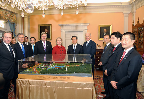 U.S. Secretary of State Hillary Rodham Clinton, U.S. Vice President Joseph Biden, and U.S. Secretary of Agriculture Tom Vilsack show Chinese President Hu Jintao a model of the proposed China Garden in the National Arboretum at the U.S. Department of State in Washington, D.C., on January 19, 2011.