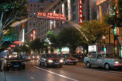 Street arch (Roving I) Tags: china signs streets lights shanghai traffic arches taxis hitachi