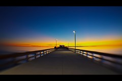 almost there (lensbaby) (Eric 5D Mark III) Tags: california light sunset sky people usa cloud blur color beach lensbaby canon pier vanishingpoint twilight unitedstates perspective atmosphere wideangle newportbeach orangecounty tone composer eos5dmarkii doubleglassoptic 042xsuperwideconversionlens