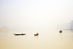 Foggy River (Tipu Kibria~~BUSY~~) Tags: winter cold nature water fog canon river eos boat foggy scene 1001nights bangladesh boatman canonef50mm18 xti 400d mawlavibazar