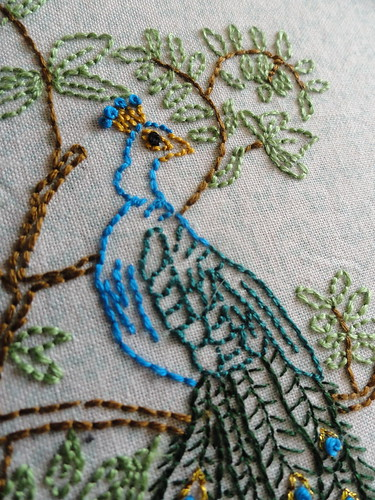 Peacock head embroidery close up