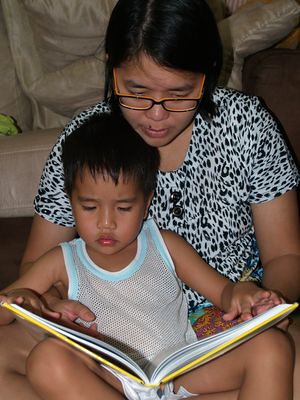 Julian reading with Mummy