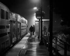 Northport Arrival (Punk Dolphin) Tags: windows people blackandwhite bw newyork cold wet fog night train platform longisland explore transportation railing lirr northport