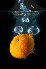 fruit splash (kubais) Tags: life light food orange black cold green nature water fruit night canon river flow eos iso100 lemon jump healthy energy aqua underwater power drink juice ripple background live beverage explosion drop fresh clean clear health 7d bubble mineral citrus alive lime diet splash f18 refreshing liquid consume vital dieting ingredient vitamin splashing gupr