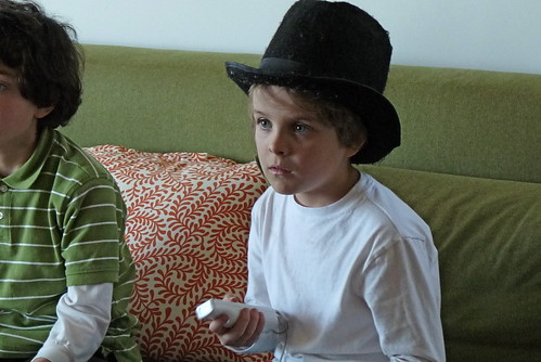 playing wii in his willy wonka hat