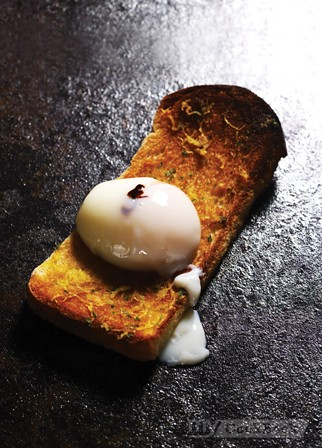 45-minute Poached Egg with Black Cream Sauce served on Dried Scallop Toast