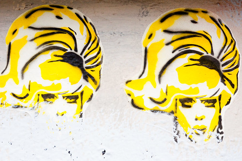 tall-haired blonde women, sticker-graffiti from the Haight