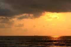 The sun, the ocean, and the ship (Sonali Mangal) Tags: ocean sunset sea sun sunlight india reflection nature clouds golden ship dusk vizag naturephotography partialsun