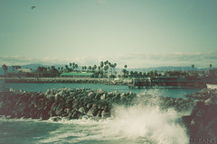 splash. (Alli Jiang) Tags: ocean california sea green beach water photoshop canon vintage pier photo rocks waves gloomy post outdoor wave naturallight manipulation splash redondo seashore 2010 redondobeach lightroom fadedcolor cooltone greentone t2i allijiang posprocesstone