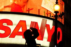 Lady and the lights (Peter Denton) Tags: street city uk red england urban london tourism silhouette night catchycolors advertising lights europe candid eu piccadillycircus sanyo silueta advertisements londonist canoneos400d peterdenton